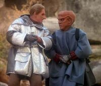 Odo and Quark climbing mountain