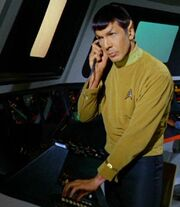 Spock with earpiece and scope