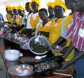Nyakach trainers ready to serve solar cooked food.jpg