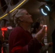 Bajoran member of the Cult of the Pah Wraiths praying