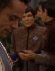 Romulan committee member at banquet