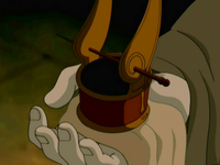 Iroh holding out the headpiece