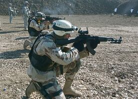 Iraqi soldier with AKM