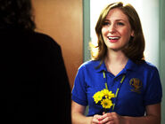Holly J In Her Degrassi Uniform Looking At Fiona With Three Yellow Flowers In Her Hand