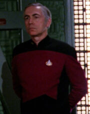 Command division officer in transporter room, 2366