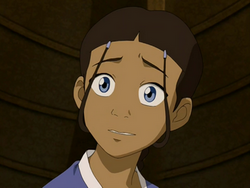 Katara smiles awkwardly