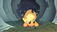 Applejack holding on to Spike&#39;s tail S1E19