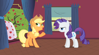 Applejack and Rarity talking next to Bloomberg S1E21