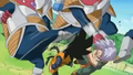 Kado kicks goten in the face and hits trunks in the face