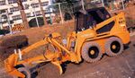 Hitachi SX607 skid steer - 2004
