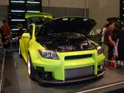 2005 yellow custom Scion tC front