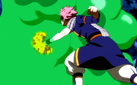 Natsu attacks the slime