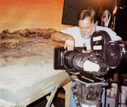 ILM's Robert Hill preparing to film the maquette-matte painting combination of Deneb IV