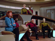Bridge crew listening to Riker