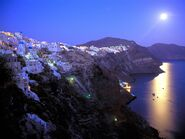 Moonrise over santorini greece