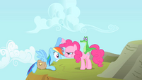 Pinkie Pie stares at Rainbow Dash while helping her up S1E25