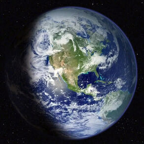 The planet Earth as seen from space, with the North American continent visible through the clouds
