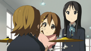 Ritsu absorbed in thoughts