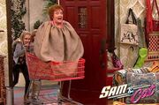 Nona being pushed in a shopping cart