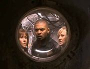 "Mickey, Jackie and Sarah hide from the Daleks in a shot that demonstrates an effect nicknamed the ""Harper treatment""."